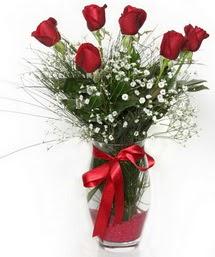 7 adet gülden cam içerisinde güller  İstanbul çiçek , çiçekçi , çiçekçilik