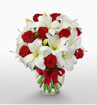 İstanbul kaliteli taze ve ucuz çiçekler  1 dal kazablanka 11 adet kırmızı gül vazosu